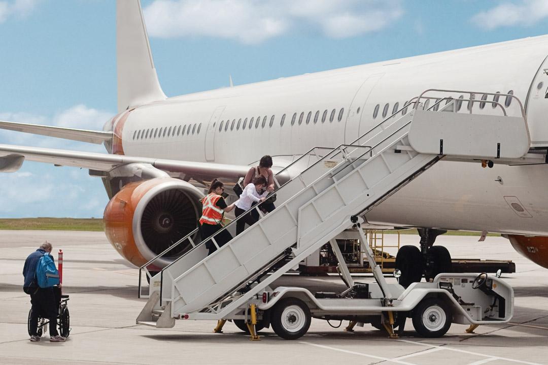 Patient boarding a plane